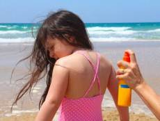 girl getting sunscreen