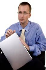 man with glasses and laptop