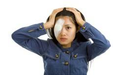 girl with eye injury