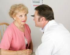 optometrist examining elder lady