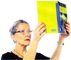 lady holding book high